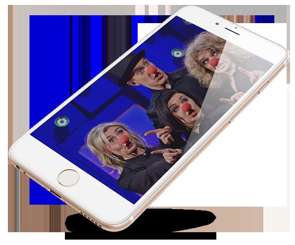 Mobiltelefon med bild på artister med clownnäsor